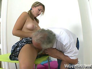 Tricky old teacher impales a sexy young hottie in the classroom
