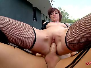 Redhead MILF in stockings gets hardly screwed on the poolside