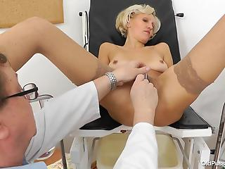 Dirty gynecologist explores MILF's shaved pussy in the hottest way