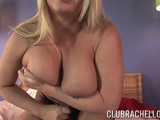 Big-boobed mom with shaved pussy is playing with a huge toy