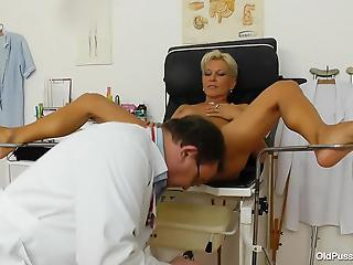 Nasty doctor is playing with a wide-opened mature pussy