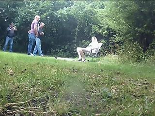 Astonishing outdoor blowbang and masturbation action with a MILF