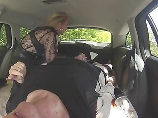 Two stunning mature ladies are playing with sex toys in the van