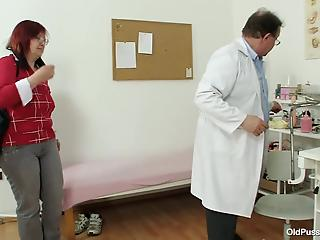Redhead mature opens her pussy for a completely perverted doctor