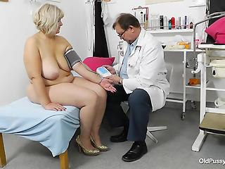 Chubby mature with big tits and hairy pussy spreads her legs