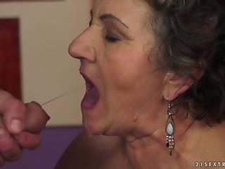 Experienced fucker cums in wide-opened mouth of a lusty mature