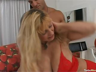 Toned young athlete pounds a big-breasted blondie housewife