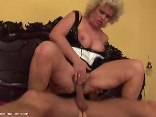 Curly-haired busty mature enjoys hardcore dick riding in the bedroom