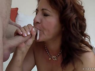 Red-haired cougar lets young partner drill her hairy peach