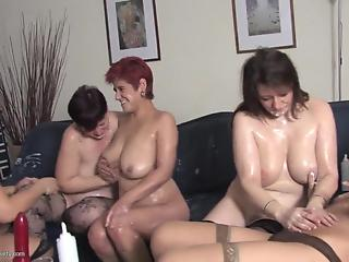 Five horny lesbian matures have nasty group sex in living room