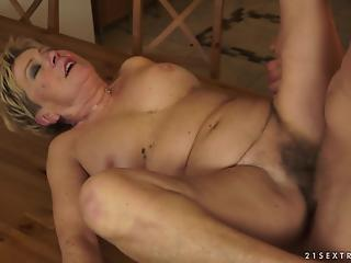 Bald buddy penetrates hairy pussy of sexy granny in kitchen