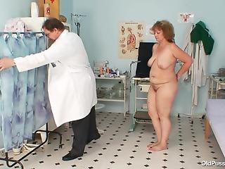 Attractive granny came at gynecologist for pussy examination