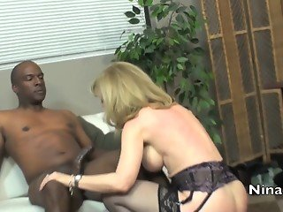 Blonde MILF sucks and rides black cock in office