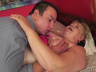 Guy dildoes pussy of excited granny and his dick invades it