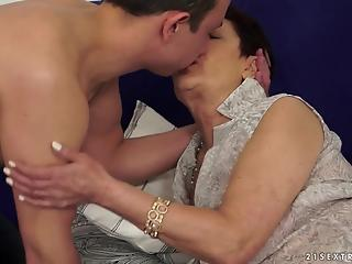 GILF is getting hardly fucked by young man with a big cock