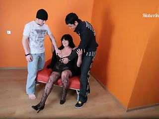 Two young pals are fucking a cock-swallowing mature brunette